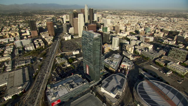 aerial shot of downtown los angeles viewed from the west. - staples centre stock videos & royalty-free footage