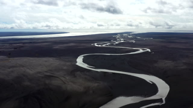 aerial shot of dramatic river in south iceland - flowing stock videos & royalty-free footage