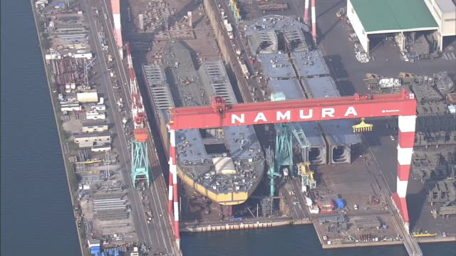 aerial shot of drydock at imari plant of namura shipbuilding co ltd one of the major shipbuilders in japan - dry dock stock videos & royalty-free footage