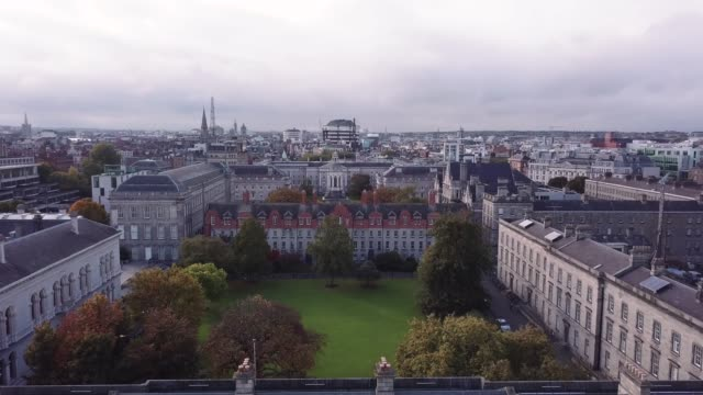 aerial shot of dublin's trinity college on an autumn afternoon - アイルランド点の映像素材/bロール