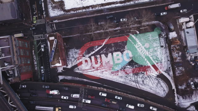 aerial shot of dumbo, brooklyn - suspension bridge stock videos & royalty-free footage