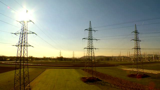 aerial shot of electricity pylons - power line stock videos and b-roll footage