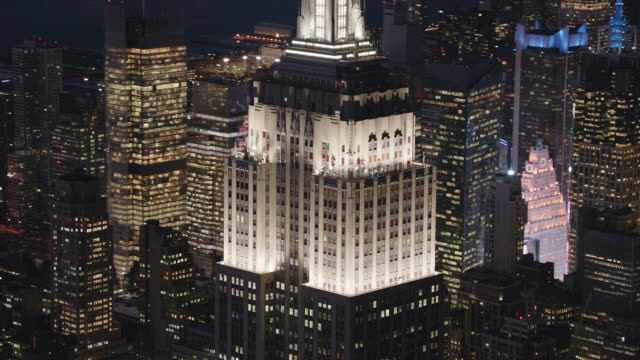 aerial shot of empire state building at night with lights on - 2013 stock videos and b-roll footage