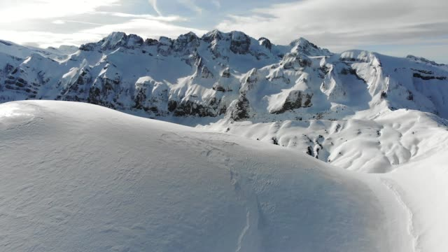 aerial shot of european alps in avoriaz, france. - alpi video stock e b–roll