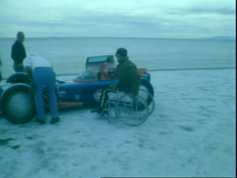 aerial shot of experimental mickey thompson racing team indy race car driving on salt flats / thompson race car stopping on salt flat driver opening... - bonneville salt flats stock videos and b-roll footage