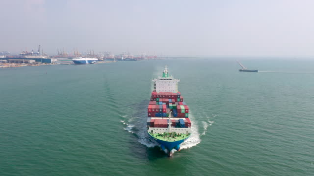 aerial shot of export container ship in ocean - wake water stock videos & royalty-free footage