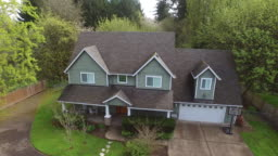 Aerial shot of family home and yard