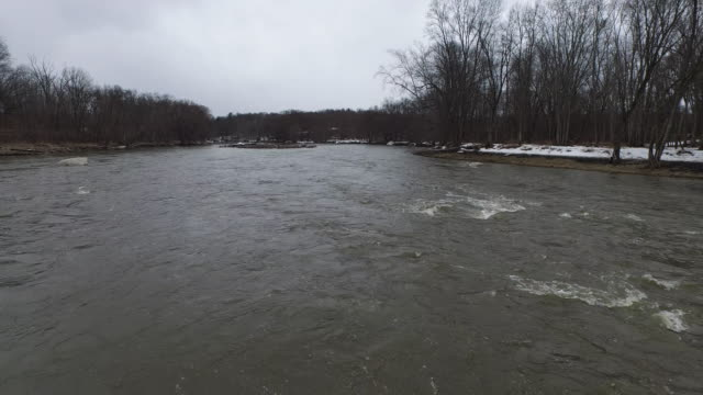 aerial shot of fast moving river in country during winter - new paltz stock videos and b-roll footage