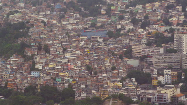 aerial shot of favela in rio de janeiro, brazil - favela stock videos and b-roll footage