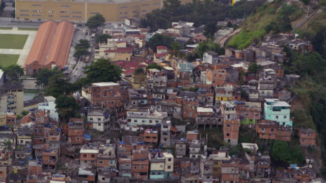 aerial shot of favela on the mountainside in rio de janeiro, brazil - favela stock videos and b-roll footage