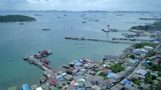 aerial shot of fishing village at sichang island is located in the middle of the gulf of thailand. - fishing village stock videos and b-roll footage