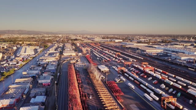 aerial shot of freight trains in warehouse district - vernon, california - shunting yard stock videos and b-roll footage