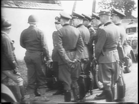aerial shot of german soldiers in stockade / montage of soldiers german soldiers on horseback pass allied troops allied troops in street surrendering... - arrendersi video stock e b–roll