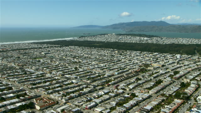 Aerial shot of Golden Gate Park and the largely residential districts of Sunset and Richmond in San Francisco.