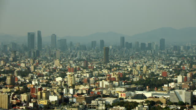 aerial shot of hazy mexico city skyline - 北半球点の映像素材/bロール