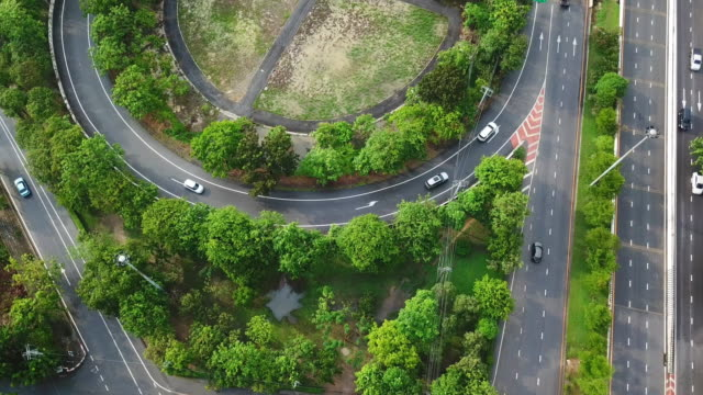 aerial shot of highway and public park - curve stock videos & royalty-free footage