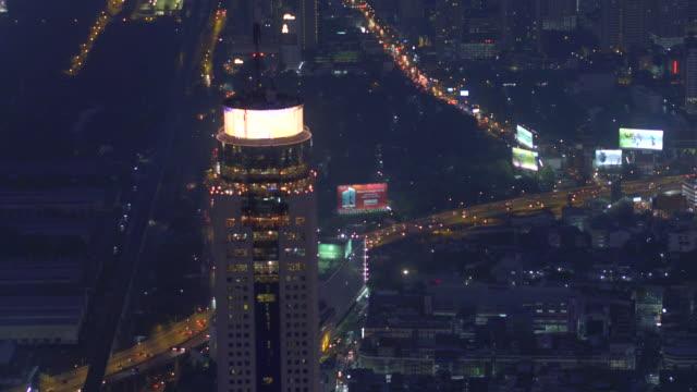 aerial shot of highway at night , bangkok city , thailand - bangkok stock videos & royalty-free footage