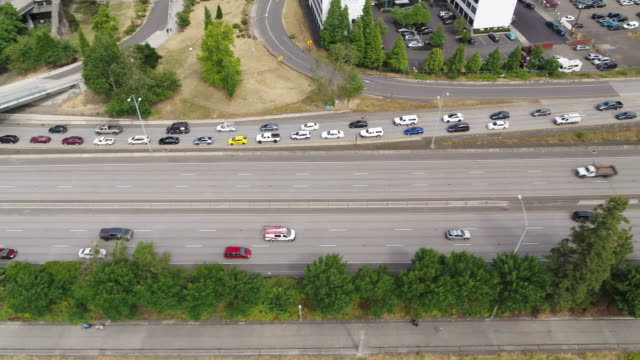 aerial shot of highway passing through portland, oregon - portland oregon summer stock videos & royalty-free footage