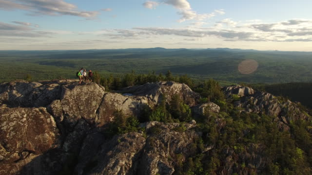 aerial shot of hikers atop mountain ridgeline. - maine stock videos & royalty-free footage