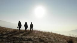 Aerial shot of hikers walking along a mountain ridge