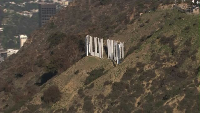 aerial shot of hollywood sign with pan-out to city - hollywood california stock videos & royalty-free footage