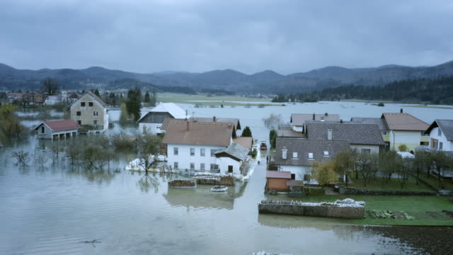 Aerial shot of houses in a flooded valley