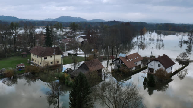 Aerial shot of houses in flooded basin