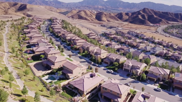 aerial shot of housing development - santa clarita video stock e b–roll