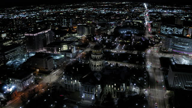 aerial shot of illuminated colorado state capitol in city at night, drone flying upward - denver, colorado - politics abstract stock videos & royalty-free footage