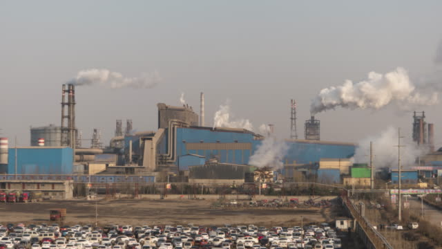 T/L MS HA Aerial Shot of Industrial District with Smokestacks