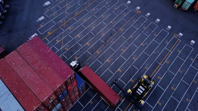 vidéos et rushes de aerial shot of intermodal shipping yard - transport