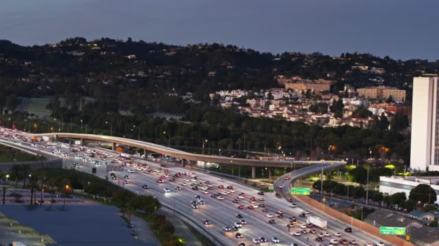 aerial shot of interstate 405 in west los angeles - westwood neighborhood los angeles stock videos & royalty-free footage