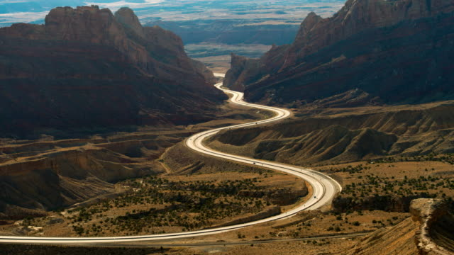 aerial shot of interstate 70 in utah winding through mountains - san rafael swell stock videos and b-roll footage