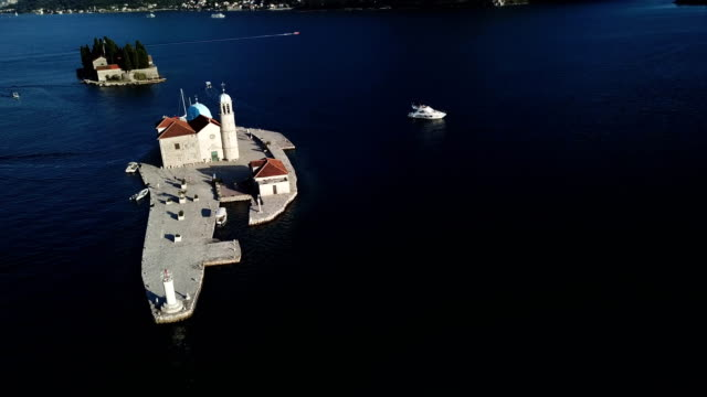 aerial shot of island with old church and monastery and old city of perast - shoot with drone - perast stock videos and b-roll footage