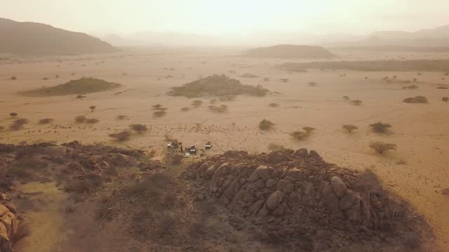 aerial shot of jeeps in iona national park, angola, africa - national park stock videos & royalty-free footage
