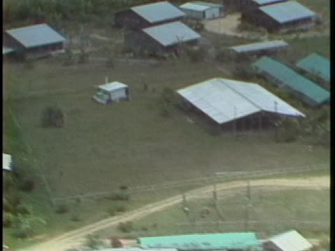 aerial shot of jonestown, one year after jim jones ordered his followers to kill themselves. - non urban scene stock videos & royalty-free footage