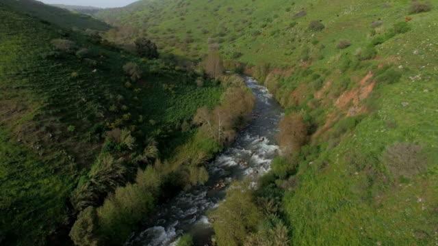 aerial shot of jordan river in upper galilee, israel  - jordan middle east stock videos and b-roll footage