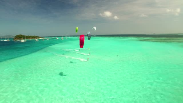 aerial shot of kitesurfer on flat water in the caribbean - water sport stock videos and b-roll footage