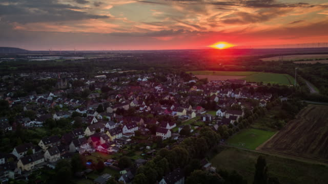 Aerial shot of Landscape with a town in Germany  at Sunset