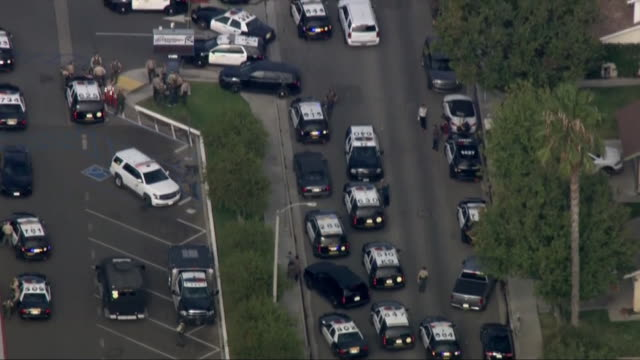 aerial shot of law enforcement vehicles responding to a shooting at saugus high school in santa clarita, california. - santa clarita stock videos & royalty-free footage