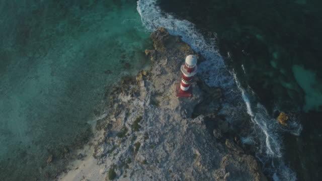 aerial shot of lighthouse marina on coastline - mayan riviera stock videos & royalty-free footage