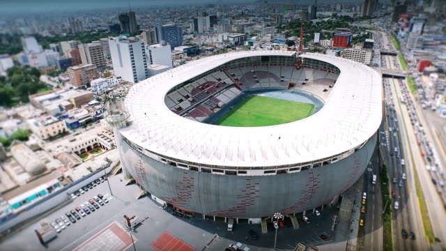 vídeos de stock e filmes b-roll de 4k aerial shot of lima peru national stadium - football