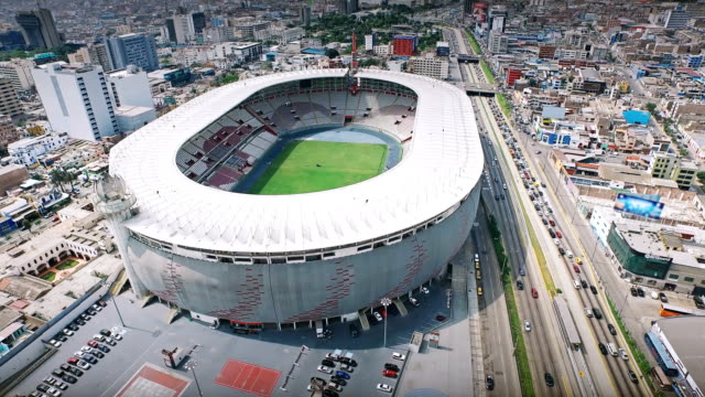 4k aerial shot of lima peru national stadium - stadium stock videos & royalty-free footage