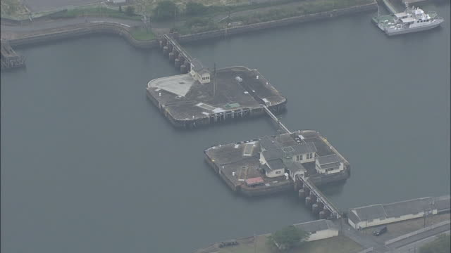 vidéos et rushes de aerial shot of lock gate of miike port in fukuoka prefecture; one of the sites of japan's industrial revolution in the meiji era: world... - unesco