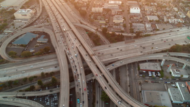 aerial shot of los angeles freeways at sunset - golden hour stock videos & royalty-free footage