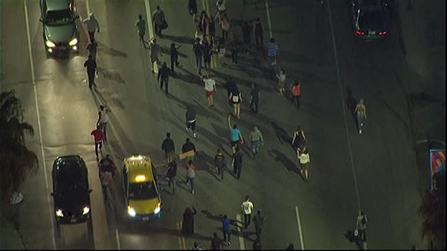 aerial shot of los angeles where demonstrators are marching against the acquittal of george zimmerman for the murder of trayvon martin - crime or recreational drug or prison or legal trial stock-videos und b-roll-filmmaterial