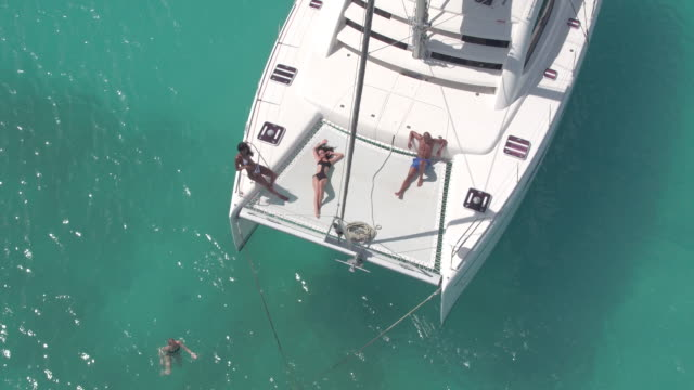 aerial shot of luxury yacht - anchored stock-videos und b-roll-filmmaterial