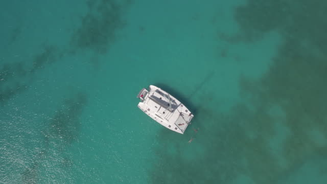 aerial shot of luxury yacht - anchored stock videos & royalty-free footage