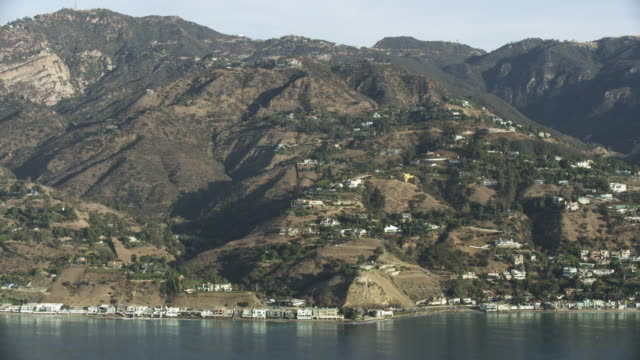 aerial shot of malibu road from above the ocean - malibu stock videos & royalty-free footage