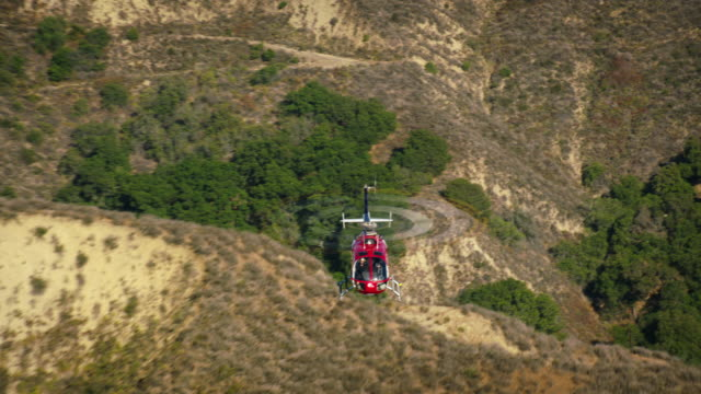 aerial shot of mbb bo 105  helicopter, looking at the front of the cockpit, over foothills near camarillo, california, daytime. - camarillo stock videos & royalty-free footage